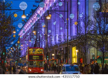 LONDON, UK - DECEMBER 30, 2015: Selfridges department store. Christmas lights decoration at Oxford street and lots of people walking during the Christmas sale, public transport, buses and taxies