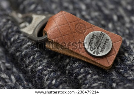 London, UK - December 17, 2014: Superdry vintage zip logo on knit wear  - stock photo