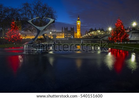 LONDON, UK - DECEMBER 15TH 2016: A view of a beautiful illuminated Christmas tree with the Houses of Parliament in the background, London on 15th December 2016.