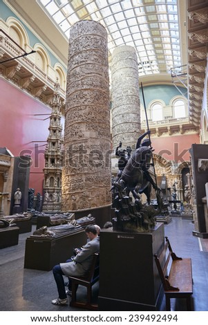 LONDON, UK - DECEMBER 20: The Cast Courts at the Victoria and Albert Museum. December 20, 2014 in London. The room includes a plaster copy of Trajan's column, divided in 2 sections due to its height. - stock photo