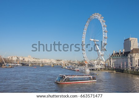 London, UK - December 22, 2016 : The London Eye near the River Thames in London, England. The London Eye is a giant Ferris wheel on the South Bank of the River Thames.