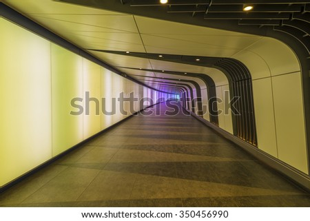 LONDON, UK - DECEMBER 12, 2015: The 90 meters long curved pedestrian tunnel features an LED integrated lightwall and links St Pancras International and Kingâ??s Cross St Pancras Underground stations. - stock photo