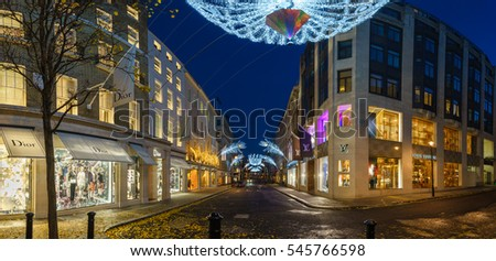 LONDON, UK - DECEMBER 12, 2016: Wide angle view of Christmas decorations at New Bond Street in London with Louis Vuitton and Dior shops
