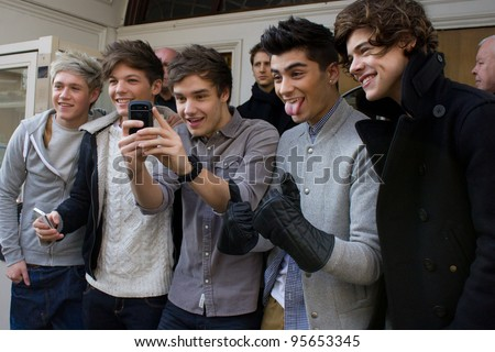 LONDON, UK - FEB. 20: Boyband One Direction lark around at the BBC Maida Vale Studios in London on the Feb 20, 2012 in London, UK