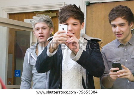 LONDON, UK - FEB. 20: Boyband One Direction lark around at the BBC Maida Vale Studios in London on the Feb 20, 2012 in London, UK - stock photo