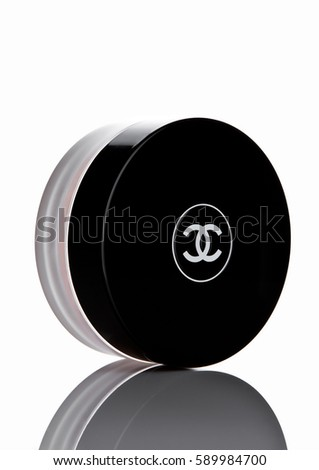 LONDON, UK - FEBRUARY 28, 2017 Chanel face cream container with black logo. On white background with reflection