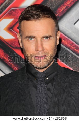 London. UK.   Gary Barlow (one of the judges) at the Red Carpet Photocall on X Factor Finals Night at Wembley Arena, London. 10th December  2011.  - stock photo