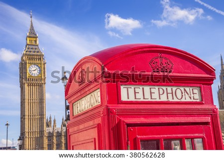 London, UK - Iconic British red telephone box with Big Ben and Double Decker bus at background on a sunny day with blue sky - stock photo