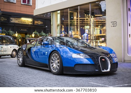 LONDON, UK - JAN 25, 2016: A Bugatti Veyron EB 16.4 on display in front of the shop of Bugatti brand in London. Fastest serial car in the world.  - stock photo