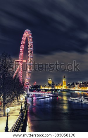 LONDON, UK; 27 JAN 2016: Atmospheric RETRO PROCESSING of London City of Westminster, London Eye, Skyline and Night from South Bank of River Thames, England, UK.