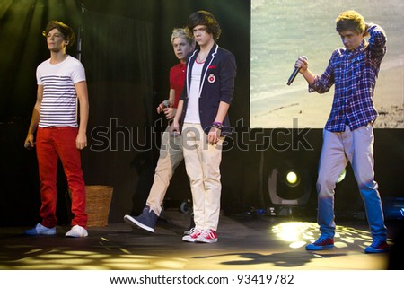 LONDON, UK - JAN. 23: One Direction Play the HMV Apollo in London on the January 23, 2012 in London, UK - stock photo
