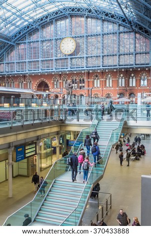 LONDON, UK - JAN 28, 2016: Travelers on the stairs at Kings Cross St Pancras station - stock photo