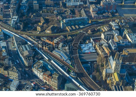 LONDON UK - JANUARY 30, 2016: Aerial view of London cityscape with roads, railway track and modern buildings
