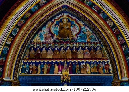 LONDON, UK - JANUARY 19 2018: Arch above Great North Door at Westminster Abbey, London illuminated at Lumiere London 2018