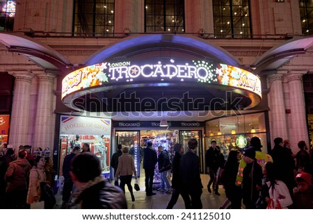 LONDON, UK - JANUARY 02: Busy street in front of entrance to London Trocadero shopping centre. January 02, 2015 in London. - stock photo