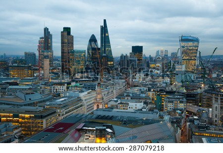 LONDON, UK - JANUARY 27, 2015: City of London, business and banking area. London's panorama at sun set.