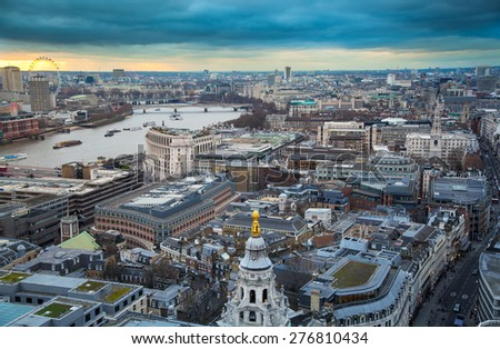 LONDON, UK - JANUARY 27, 2015: City of London, business and banking area. London's panorama in sun set. View from the St. Paul cathedral  - stock photo