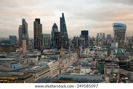 LONDON, UK - JANUARY 27, 2015: City of London, business and banking aria. London's panorama in sun set. View from the St. Paul cathedral
