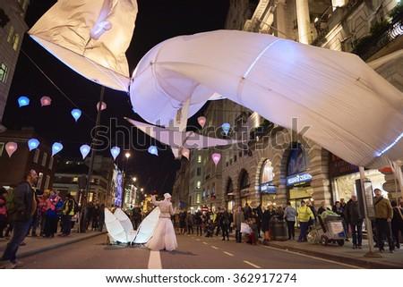 LONDON, UK - JANUARY 14: Les Lumin�©oles installation by art group Port�© par le vent. The fish-like illuminated kites are part of the Lumiere London. January 14, 2016 in London. - stock photo