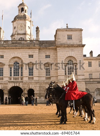 LONDON, UK- JANUARY 19: Members of the Queen's Royal Horse Guards, the Royal Life Guard Regiment, at Horse Guards Parade, during the Changing of the Guard Ceremony. January 19, 2011 in London, UK. - stock photo