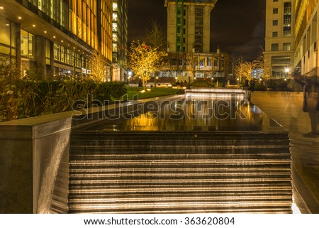 LONDON, UK - JANUARY 15, 2016: Night view of Pancras Square, a new square at the gateway to Kingâ??s Cross. The design is inspired by the atmosphere of a continental town square, but without the traffic