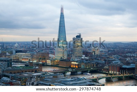 LONDON, UK - JANUARY 27, 2015: Shard of Glass, panoramic view City of London - stock photo