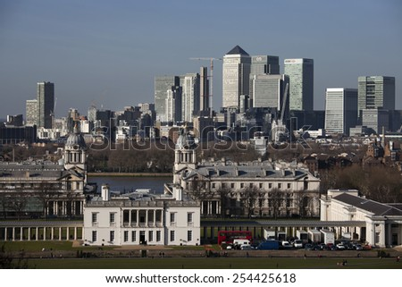 LONDON, UK - January 7 2015: The magnificent view from the Greenwich Observatory taking in sights such as Docklands, Canary Wharf  and the Royal Naval College in London - stock photo