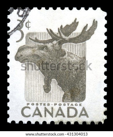 London, UK, January 15 2012 - Vintage 1953 Canada cancelled postage stamp showing an engraved image of an elk celebrating national wildlife wee