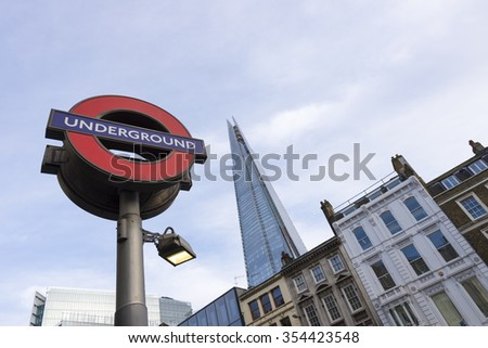 LONDON, UK - JEN 16: A London Underground station sign shown with the Shard de-focused in the background shown on Jenuary 16, 2015 in London, UK.