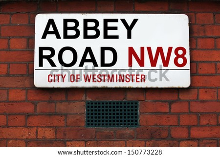 LONDON, UK - JULE 06: Abbey Road sign at recording studios made famous by the 1969 Beatles album jule 06, 2011 in London, UK  - stock photo