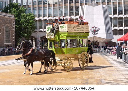 LONDON, UK-JULY 11: A 1901 Horse Drawn Garden Seat Omnibus parades in front of dignitaries and visitors , in the annual Cart Marking Ceremony. July 11, 2012 in London UK. - stock photo
