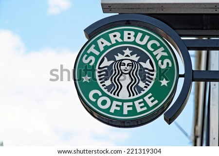 LONDON, UK - JULY 1, 2014: A logo of a Starbucks Coffee coffeehouse. Starbucks is the largest coffeehouse company in the world, with 20,891 stores in 62 countries (2013). - stock photo