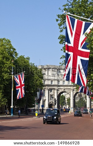 LONDON, UK -Â? JULY 9, 2013: A London Taxi drives up The Mall with Admiralty Arch in the background.