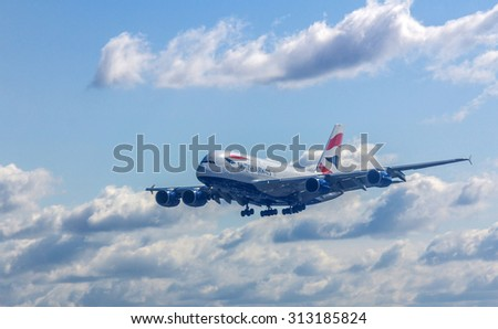 LONDON, UK - JULY 25, 2015: British Airways airplane arriving at London Heathrow Airport. Heathrow is the busiest airport in the United Kingdom and the busiest airport in Europe by passenger traffic. - stock photo