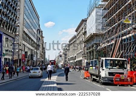 LONDON, UK - JULY 1, 2014: Busy Oxford street in London. It is the the biggest shopping street in Europe, visited by millions of tourists. - stock photo