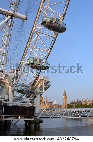 London, UK - July 17, 2013; Closeup detail of the London Eye with the Thames River, Beg Ben and Houses of Parliament in the background.