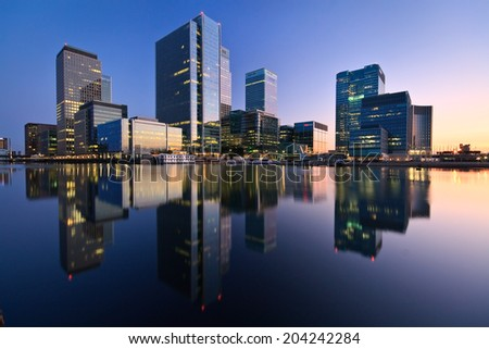 London, UK - July 30 2011: Evening in the South Dock and Canary Wharf at the background. - stock photo