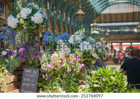 LONDON, UK - 22 JULY, 2014: Flower shop Covent Garden market, one of the main tourist attractions in London, known as restaurants, pubs, market stalls, shops and public entertaining.