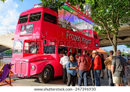 LONDON, UK - JULY 1, 2014: Frozen yogurt sold from the iconic double-decker red bus The Festival of Love at the Southbank Centre From 28 June 2014 to 31 August 2014. - stock photo