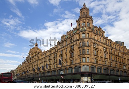 LONDON, UK - JULY 22: Harrods Department Store and traffic along Knightsbridge in Kensington on July 22, 2011 in London, UK. Harrods is the most famous department store in the world.