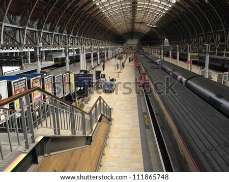 LONDON, UK - JULY 19: Interior of Paddington railway station on July 19, 2012, London, UK. Train station has recently been modernized, it's terminal for the dedicated Heathrow Express airport service. - stock photo