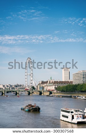 LONDON UK - JULY 10: London Eye and the River Thames with its boats on 10 July 2015