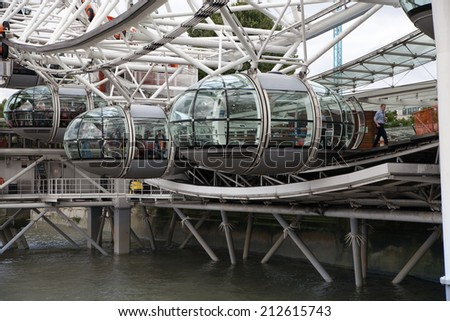 LONDON, UK - JULY 29 2014: London eye, part of great engineering construction. South walk of river Thames