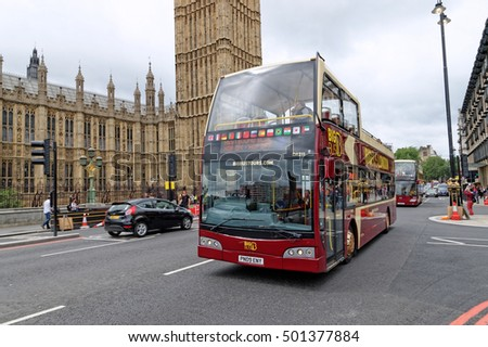 LONDON, UK - JULY 8, 2016: London tour bus on Westminster bridge. Open-top tour bus with audio guide, various languages available, is the great way see the London's major sights in short time.