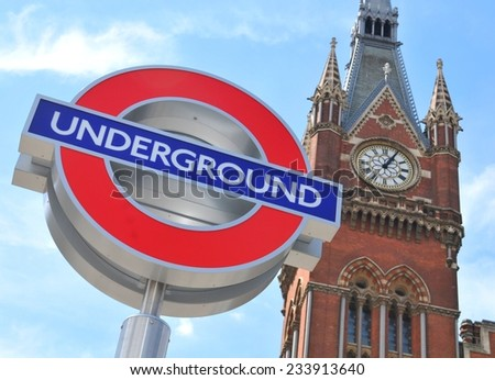 LONDON, UK. JULY 9, 2014: London Underground sign against blue sky and old architecture in central London. - stock photo
