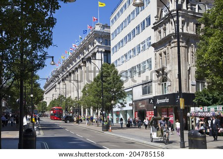 LONDON, UK - JULY 03, 2014: Oxford street shopping mail with famous fashion boutiques and super stors - stock photo