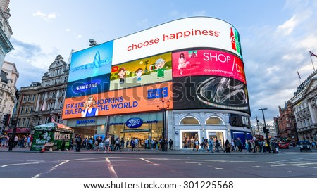 London, UK - July 28, 2015 - People and new famous advertisements in Piccadilly Circus in London. A famous public space in London's West End, it was built in 1819 to join Regent Street.