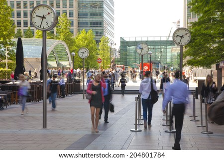 LONDON, UK - JULY 03, 2014: People blur. Office people moving fast to get to work at early morning in Canary Wharf aria - stock photo