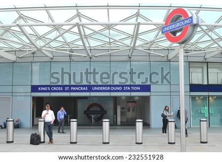 LONDON, UK - JULY 9, 2014: People wait outside the King's Cross underground station in London. - stock photo