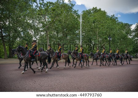 LONDON, UK - JULY 3, 2016: Queen's Guards cavalry parade during traditional Changing of the Guards ceremony at Buckingham Palace. This is one of the most popular tourist attractions in London - stock photo
